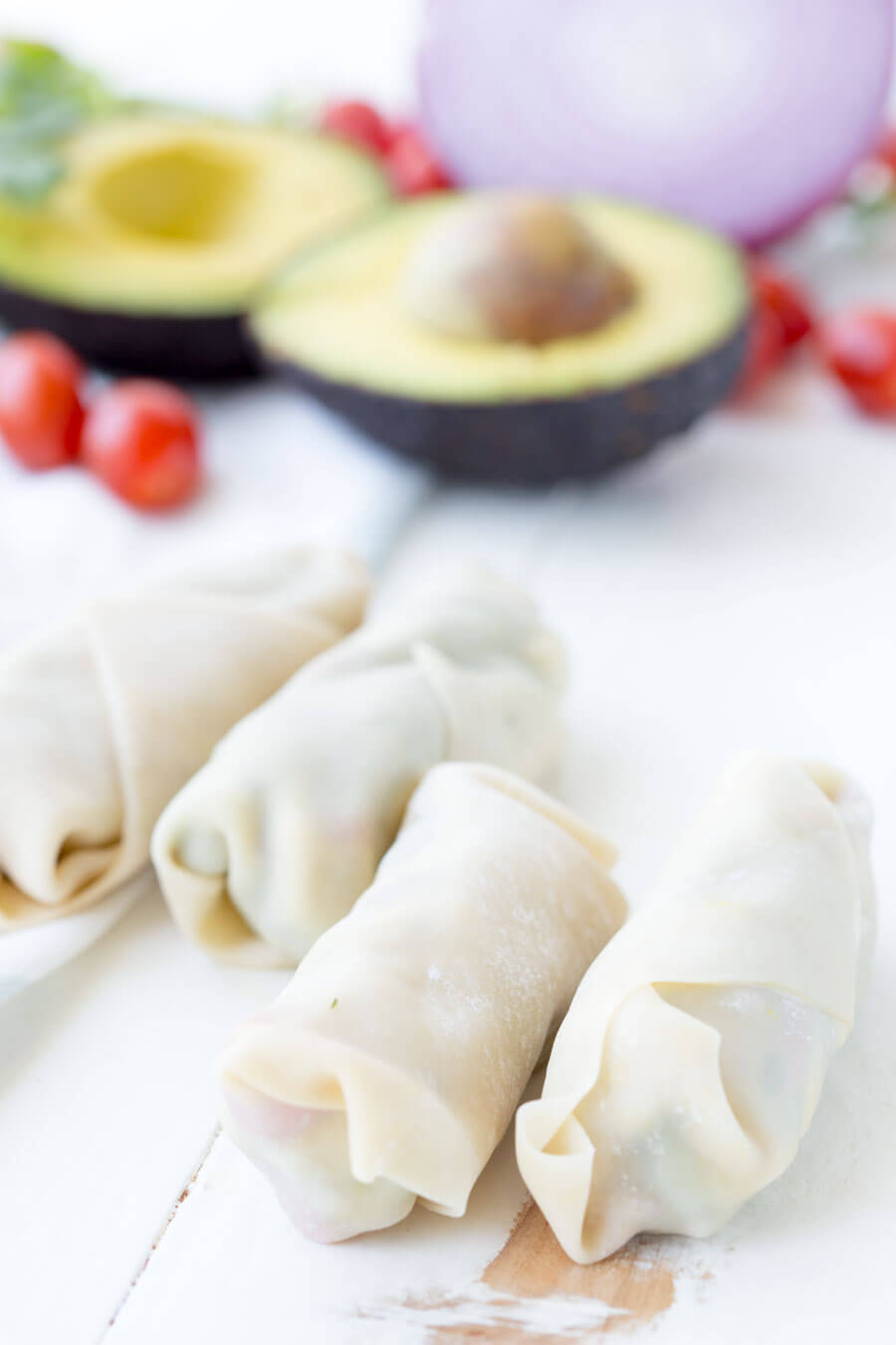 Avocado Egg Rolls: Crunchy egg roll wrapper filled with chunks of California Avocados, cilantro, tomatoes, red onion, and roasted red peppers; dipped in a creamy avocado ranch dipping sauce!