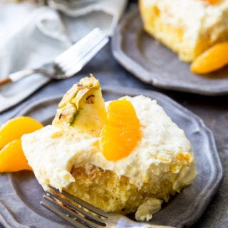 Mandarin Orange Cake with Pineapple fluff frosting or pig pickin' cake is delicious yellow cake with fruity highlights