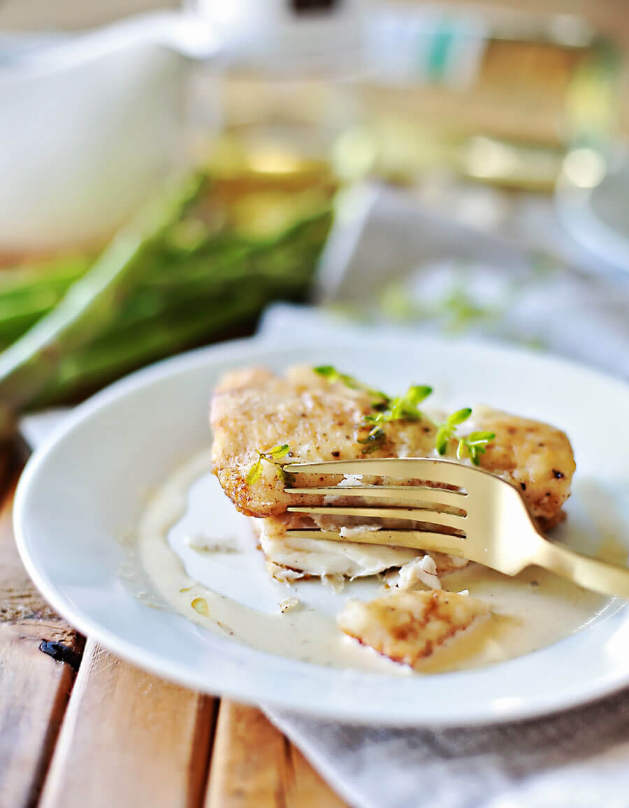 Haddock with white wine sauce recipe for fish: Flaky haddock pan fried, and served with a browned butter white wine sauce. Amazingly flaky fish, with a gourmet flavor, prepared in 20 minutes or less. This simple but elegant meal is sure to be a hit!