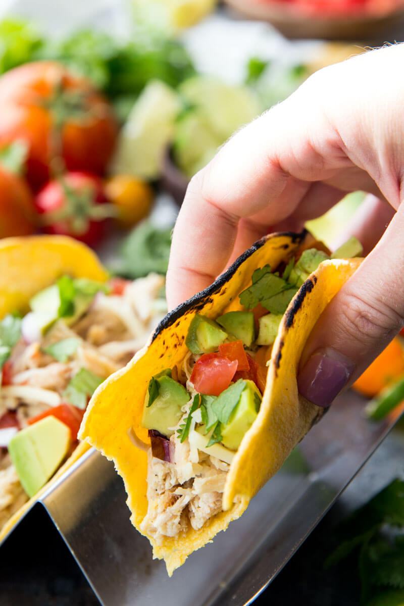 Slow Cooker Honey Lime Chicken Tacos are cooked in the slow cooker, shredded, and used in tacos, burritos, nachos, etc. It is flavor packed and super delicious.