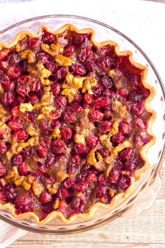 Cranberry Walnut Pie is a sweet, tart, and nutty pie that's a showstopping dessert for the holidays! Savor this pie as is, or top it with a scoop of vanilla ice cream for a treat you won't forget!
