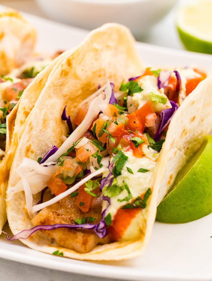 The best Lightened up delicious Baja Fish Tacos, so much flavor in these fish tacos