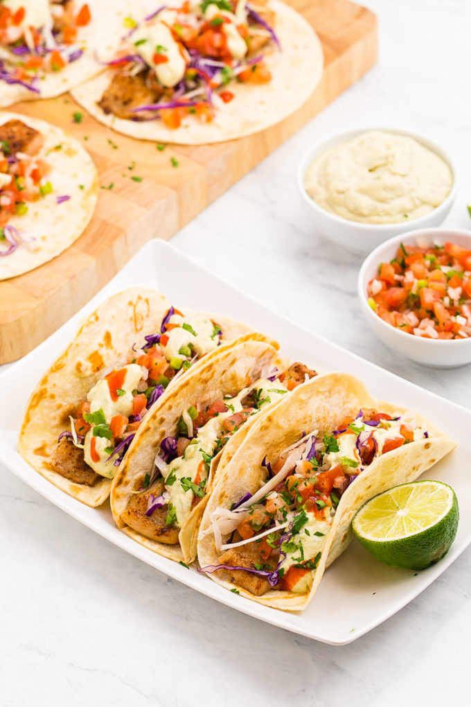 Absolutely amazing Lightened up delicious Baja Fish Tacos, so much flavor in these fish tacos with avocado cream sauce