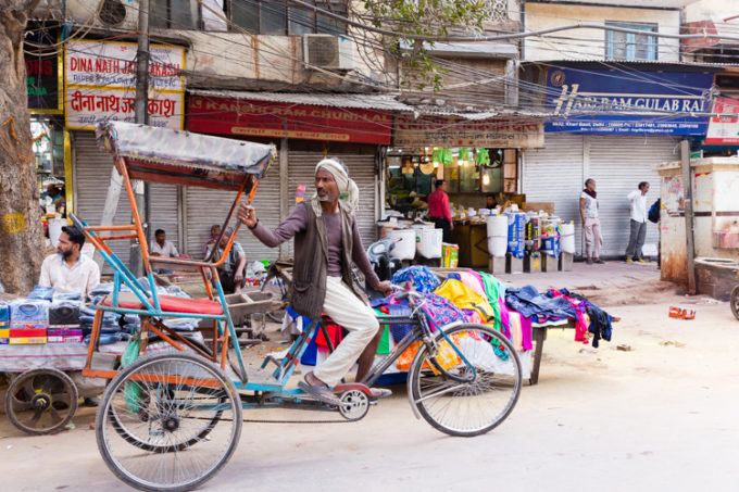 Riding a bicycle, driving a tuk tuk, the transportation of India.