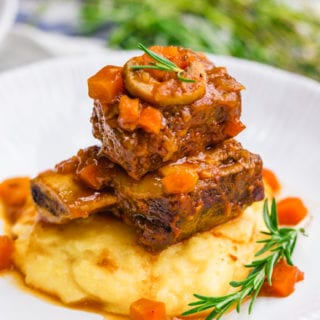 Braised short ribs, a great dinner option, served over polenta