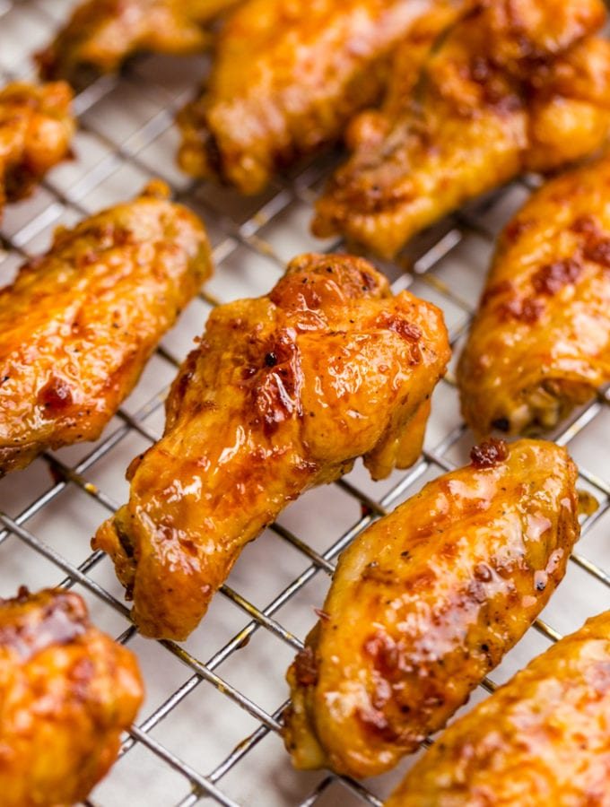 Chicken wings on a cooling rack, close up photo