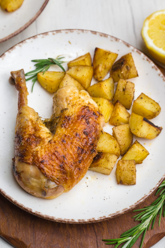 Delicious roast chicken, a whole roasted chicken leg and thigh with roast potatoes.