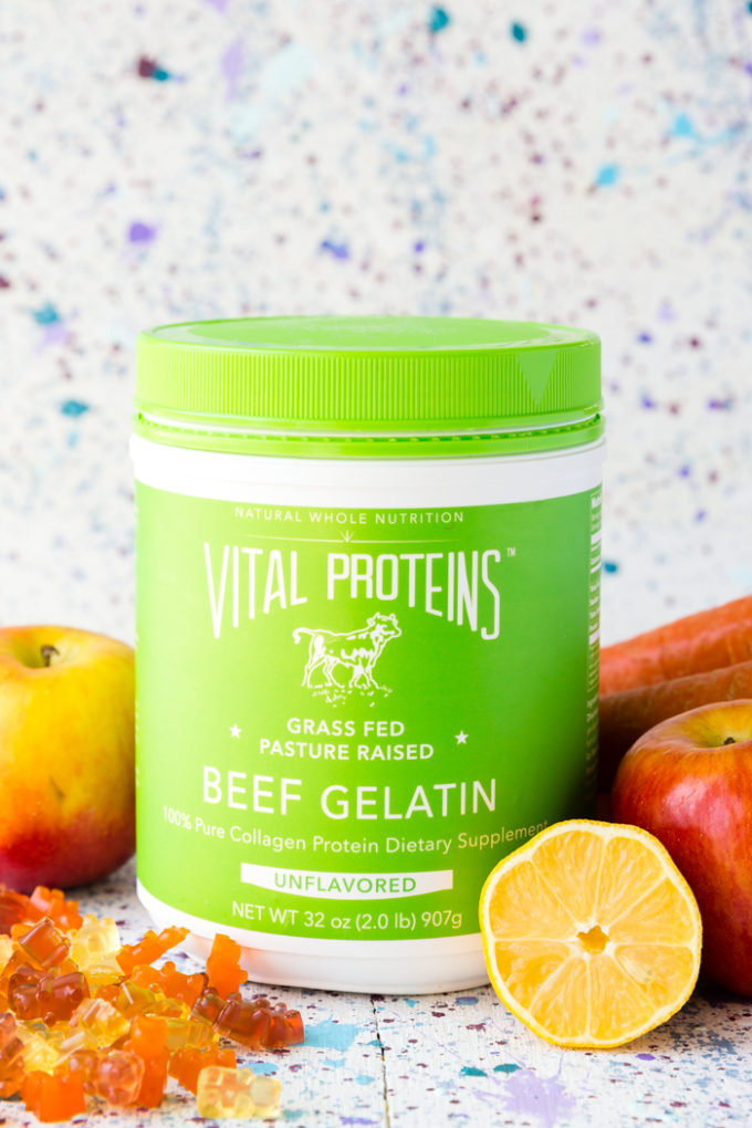 Vital Proteins Beef Gelatin surrounded by fresh fruit and gummy candy