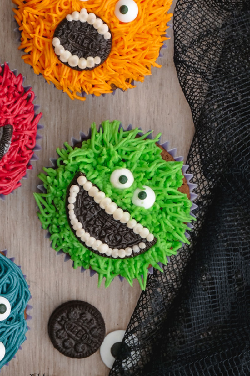 A green monster cupcake with an OREO mouth