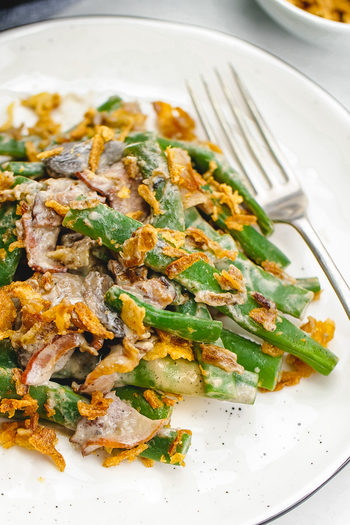 A white plate with classic green bean casserole on top