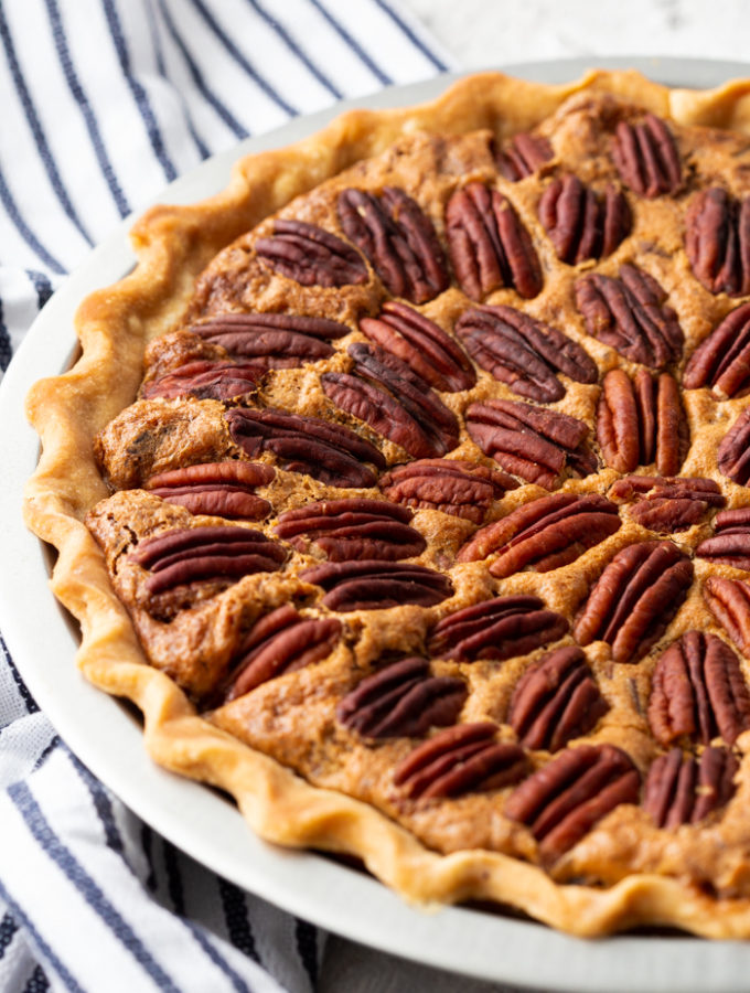 Easy, delicious, pecan pie, with a striped napkin next to it