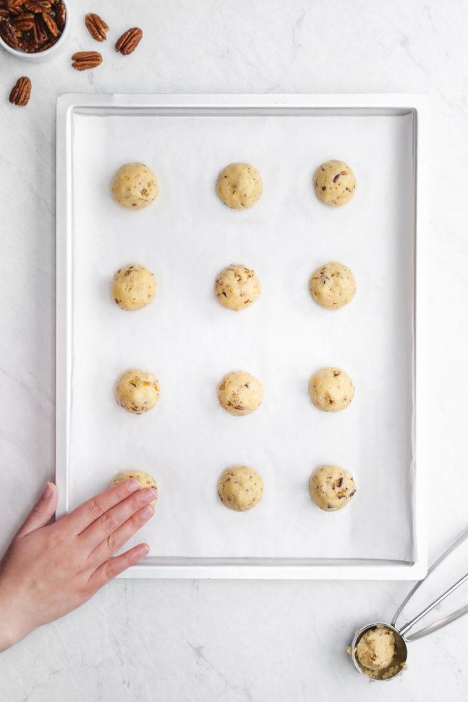 Pressing down the pecan sandies dough