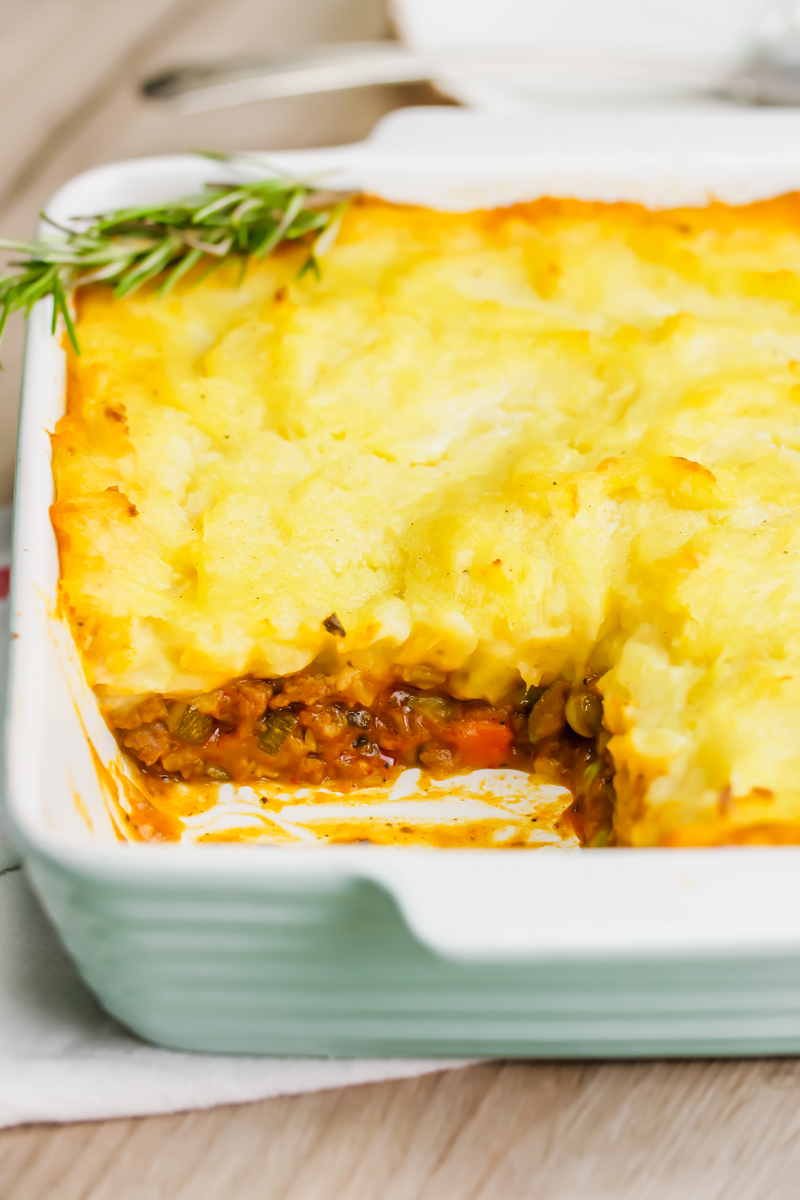 Shepherd's pie in a casserole dish, with the corner scooped out