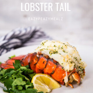 Cooked lobster tail on a white plate with parsley and lemon wedge, with the words How to cook lobster tail as an overlay