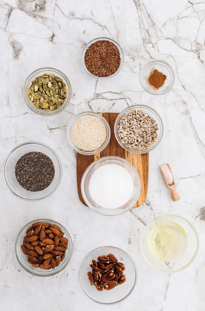 many bowls of spice for keto granola recipe on marble