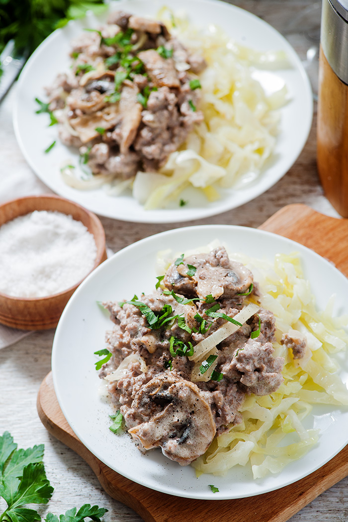 birds eye view of low carb beef stroganoff with two plates