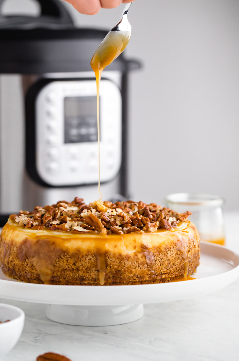 Caramel pecan cheesecake with a drizzle of caramel
