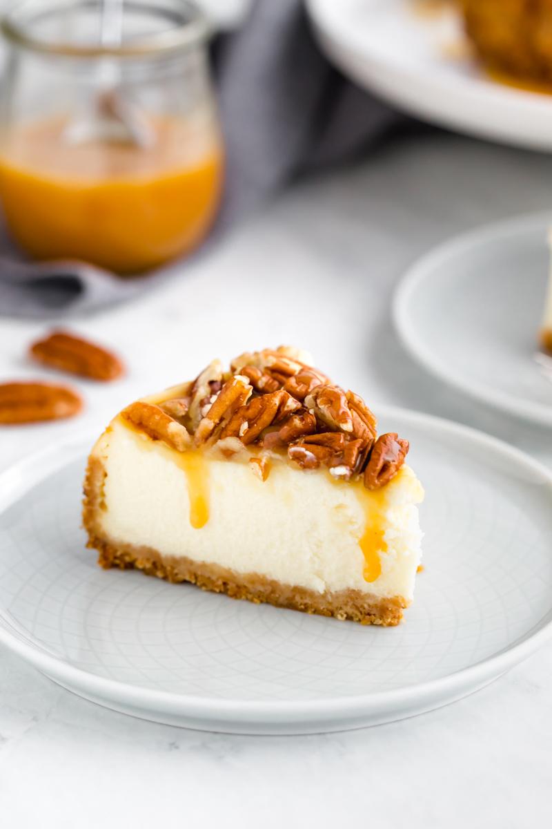Caramel pecan instant pot cheesecake slice on a white plate