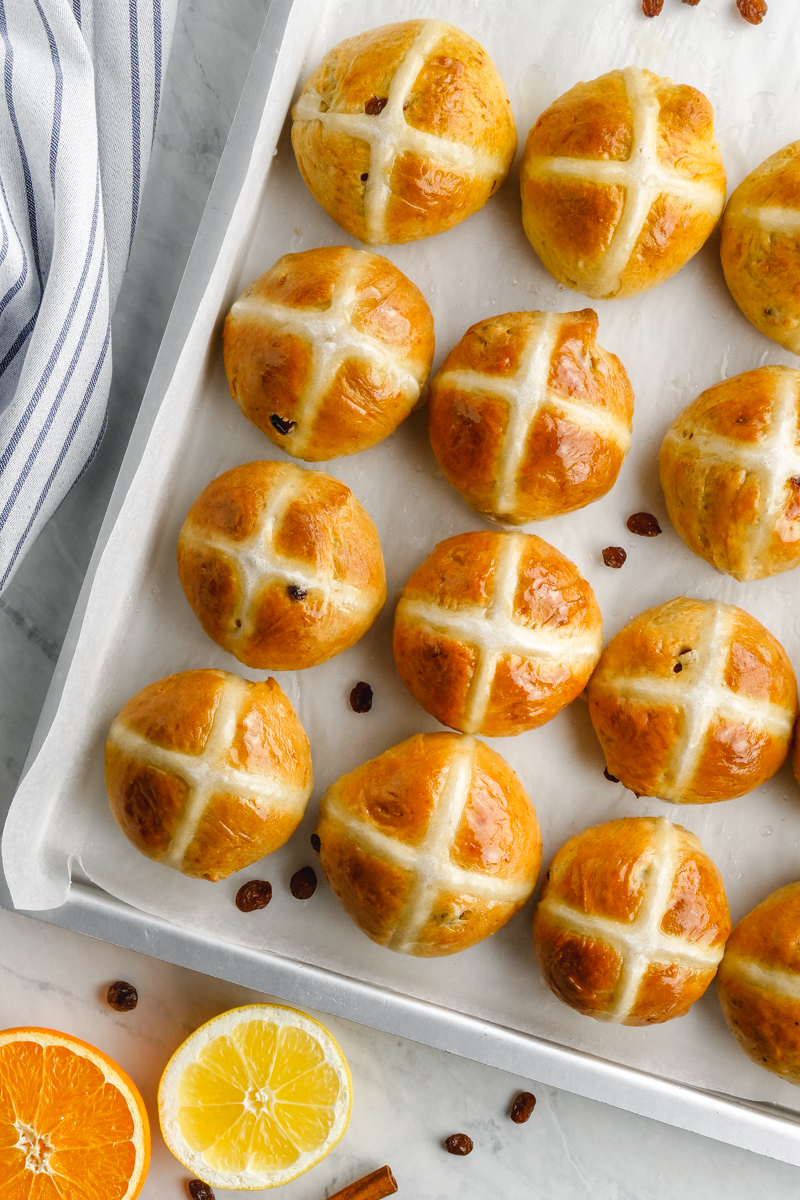 A tray of hot cross buns with fruit and spices