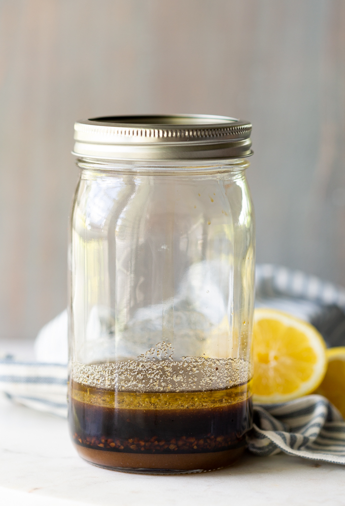 A jar filled with an all purpose marinade for chicken or pork