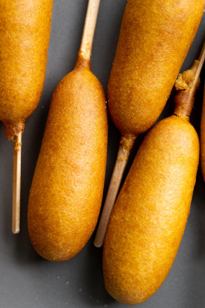 Baked corn dogs on a sheet pan