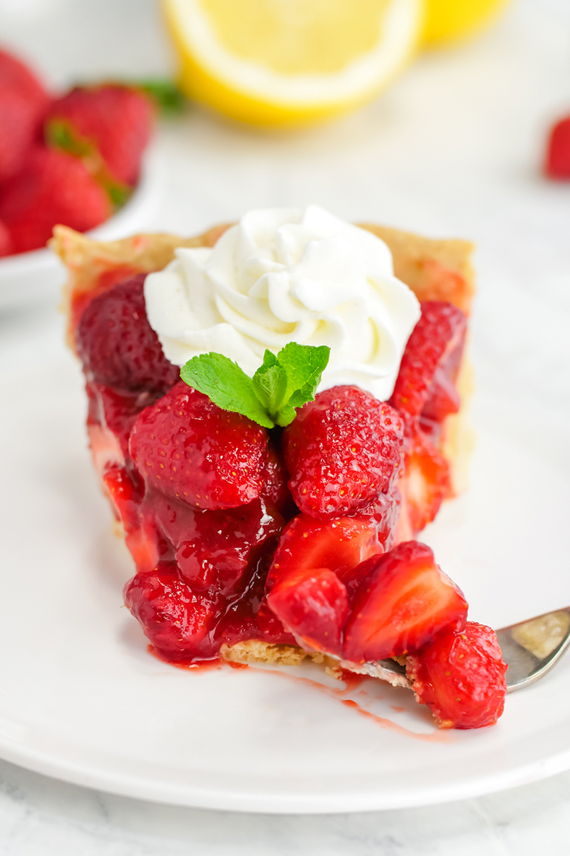 Strawberry pie with a bite taken out of it
