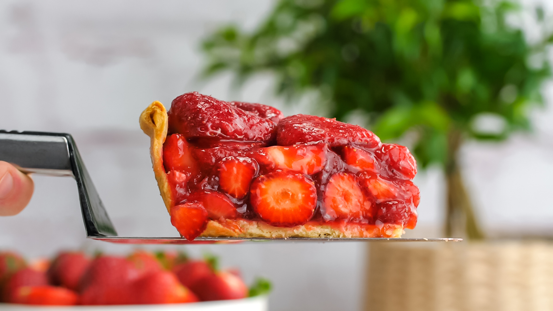 Strawberry Pie slice on a serving knife, side view of the fresh berries