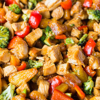 a close up of chicken teriyaki stir fry and vegetables