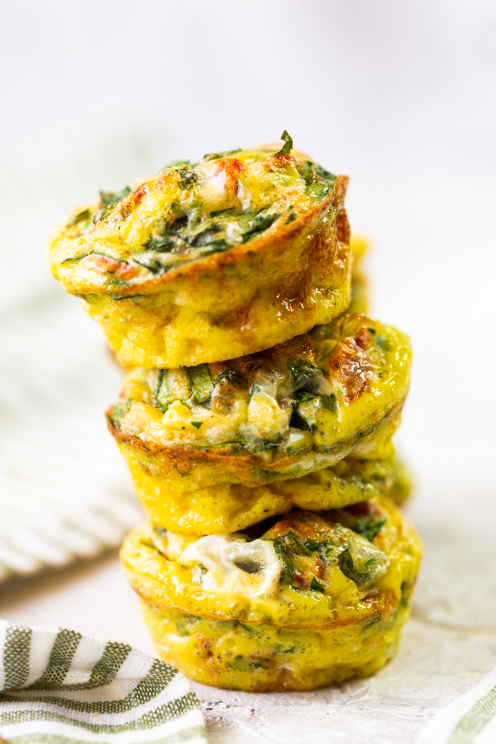 A stack of 3 sun dried tomato and egg muffins